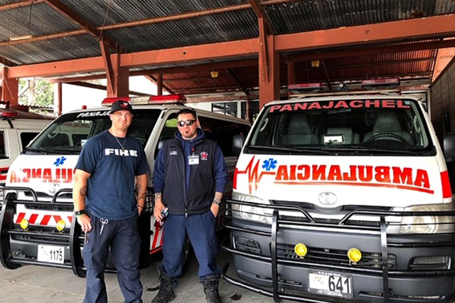 "(left) Josh Karabatsos and Kory Jones, both firefighters with the Tooele Army Depot Fire Department, Tooele, Utah, take a break while training with local firefighters - ""bomberos"" - in Panajachel, Guatemala in August 2019. Karabatsos and Jones were part of a group of 12 humanitarian volunteers supporting a local Utah organization, Humanitize Expeditions."