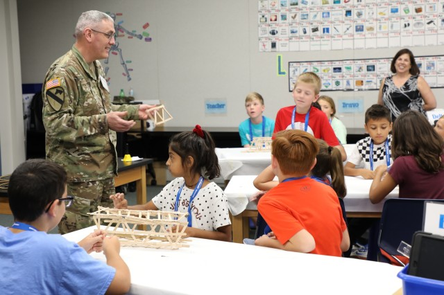 Deputy Commander for the U.S. Army Corps of Engineers Transatlantic Division Col. Stephen Bales, teaches students from Armel Elementary School in Frederick County, Virginia, about being an engineer. Bales, a civil engineer by training, was participating as a guest speaker in STARBASE, a Defense Department program designed to motivate fifth graders to explore educational opportunities in Science, Technology, Engineering, and Math (STEM) fields. The National Guard's STARBASE Academy in Winchester is the only STARBASE program in Virginia, and hosts 56-58 courses a year for area schools.