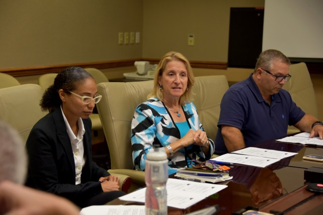 Mary Miller (center), Space and Missile Defense Center of Excellence, discusses her thoughts on the Emerging Enterprise Leader Program during an out-brief to James B. Johnson, deputy to the commander, U.S. Army Space and Missile Defense Command, Sept. 5 at Peterson Air Force Base, Colo.