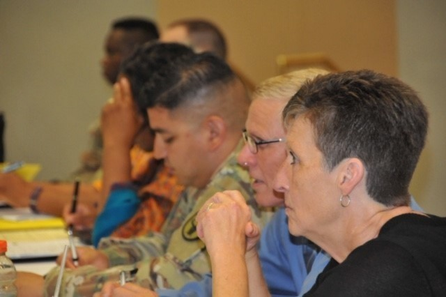 Ms. Linda Rasnake Bethesda, FRSA, Douglas Duval, JBLM FRSA, Staff Sgt. Kenon Perez, FRL, participate in Q&A during the 2019 Family Readiness and Training seminar at Fort Belvoir Virginia, August 5-9 2019. (Photo by Whitney Nichels, Army Warrior Care and Transition)