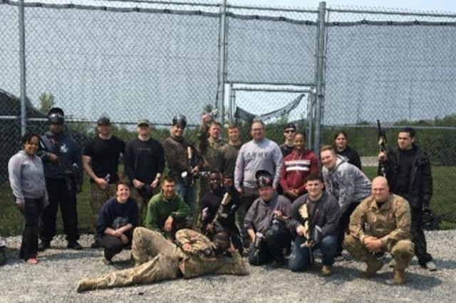 """U.S. Army Spc. Lugo (Back row 2nd from right) and the """"Paintball Squad"""" of Fort Drum Warrior Transition Battalion, May 31, 2019 at the Paintball Speedball Field at Fort Drum, New York. (Photo courtesy Fort Drum WTB)"""