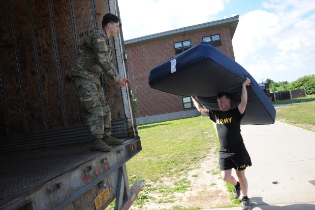 Soldiers from 2nd Battalion, 87th Infantry Regiment, 2nd Brigade Combat Team, load up a truck with old mattresses from the barracks in 2018 during a pilot recycling program with Fort Drum Public Works. Fort Drum Housing and Public Works representatives spoke with 10th Mountain Division (LI) Soldiers about quality-of-life issues during a barracks town hall meeting Sept. 16 at the Multipurpose Auditorium. (Photo by Mike Strasser, Fort Drum Garrison Public Affairs)