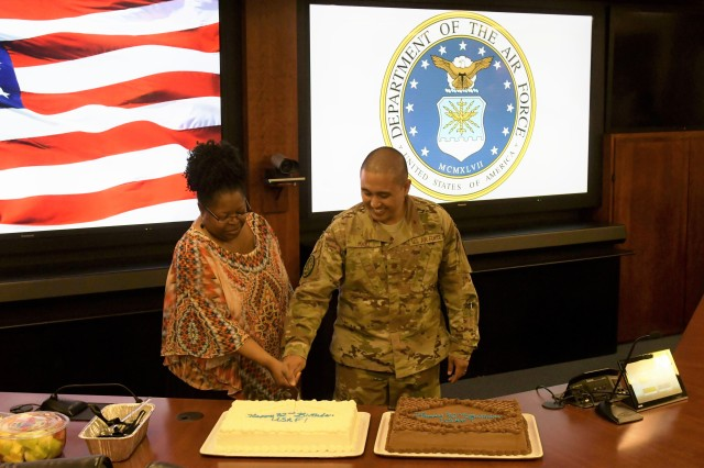 Ms. Ronda Fortson, Air Force Civilian, (left) and Maj. Chris Mayo cut the JFHQ-NCR/MDW cake celebrating the Air Force's birthday during a ceremony at Fort Lesley J. McNair, Sept. 18, 2019.