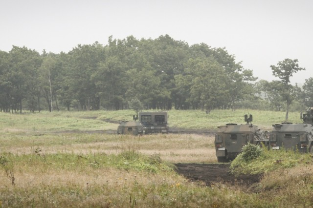 A U.S. Army High Mobility Rocket System from 5th Battalion 3rd Field Artillery stands ready next to the Japan Ground Self-Defense Force Multiple Launch Rocket System at Yausubetsu Training Area, Japan, Sept. 16. Bravo Battery, 5-3 FA BN deployed for the first time a HIMARS to Japan in support of bilateral exercise Orient Shield 2019. The HIMARS is a key capability for the U.S. Army's Multi Domain Task Force increasing the lethality of the MDTF. (U.S. Army photo by Capt. Rachael Jeffcoat)