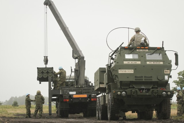 190916-A-FJ530-820 Soldiers assigned to the Western Army Field Artillery of the Japan Ground Self-Defense Force observe and facilitate reload operations on the U.S. Army High Mobility Artillery Rocket System at Yausubetsu Training Area, Japan, Sept. 16. Bravo Battery, 5th Battalion 3rd Field Artillery deployed for the first time a HIMARS to Japan in support of bilateral exercise Orient Shield 2019. The HIMARS is a key capability for the U.S. Army's Multi Domain Task Force increasing the lethality of the MDTF. (U.S. Army photo by Capt. Rachael Jeffcoat)