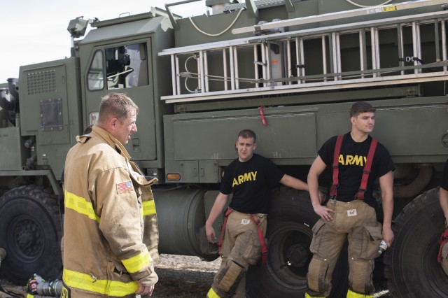 Staff Sgt. Gordon Walker, Station Chief for the 1019th Engineer Detachment Firefighters, conducts an after action review with his firefighters following training at Muscatatuck Urban Training Center in Butlerville, Ind., on Sep. 17.
