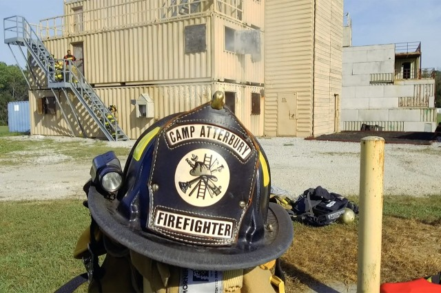 A firefighting helmet from the Camp Atterbury Fire Department awaits use by the Indiana National Guard's 1019th Engineer Detachment during training at Muscatatuck Urban Training Center in Butlerville, Ind., on Sep. 17.