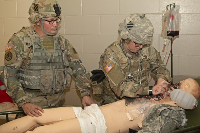 A combat medic specialist from the 3rd Infantry Division performs a needle chest decompression on a simulated burn casualty during a Medical Simulation Mannequin customer test for the recently upgraded mannequins, Sept. 10, 2019, at Fort Stewart, Georgia. The test is meant to assess the functionality and usability of medical simulation mannequins in support of the Soldier mission in and out of an operational environment. (U.S. Army photo by Sgt. Arjenis Nunez/Released)