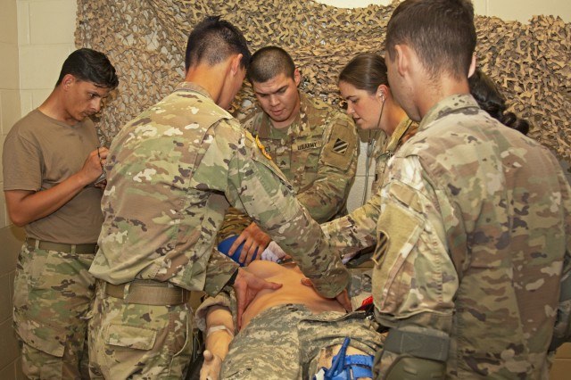 Medical Soldiers from across the 3rd Infantry Division check the vitals of a newly issued, simulated female casualty mannequin during a Medical Simulation Mannequin customer test, Sept. 11, 2019, at Fort Stewart, Georgia. Male and female mannequins are configured to simulate variable wound and amputations, replaceable skin, blood, anatomical landmarks, anatomically correct pulses and can withstand rugged handling. (U.S. Army photo by. Sgt Arjenis Nunez/Released)