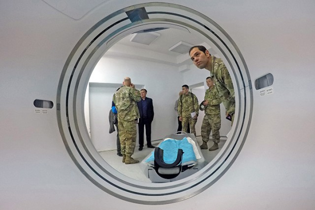 In front of a computerized tomography (CT) scanner, Civil-Military Cooperation (CIMIC) teams comprised of Ukraine and U.S. service members from Civil Affairs units review new equipment Sept. 18 at a hospital near Yavoriv, Ukraine, during Rapid Trident 2019. The CIMIC teams toured facilities that provide key public services such as water, electricity and viable life support. RT19 is an annual, multinational exercise, which involves approximately 3,700 personnel from 14 nations, that supports joint combined interoperability among the partner militaries of Ukraine and the United States, as well as Partnership for Peace nations and NATO allies.