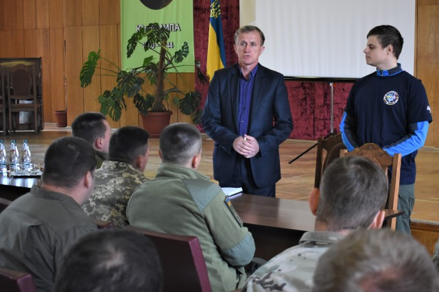 Civil-Military Cooperation (CIMIC) teams comprised of Ukraine, United Kingdom and U.S. service members from Civil Affairs units discuss vital aspects of medical capabilities with directors of the hospital, Sept. 18, during Rapid Trident 2019 near Yavoriv, Ukraine. RT19 is an annual, multinational exercise, which involves approximately 3,700 personnel from 14 nations, that supports joint combined interoperability among the partner militaries of Ukraine and the United States, as well as Partnership for Peace nations and NATO allies.