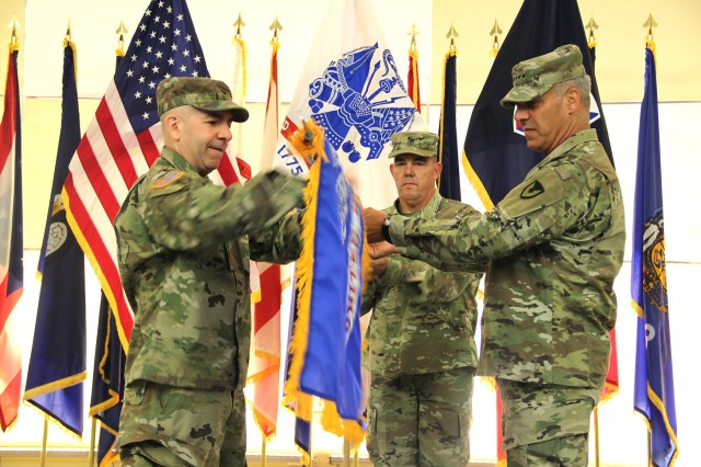 The Army's senior logistician Gen. Gus Perna (right), Commanding General of the U.S. Army Materiel Command, uncases the Army field flag with Col. Michael Lalor (left) and Sgt. Major. Corey Lord (middle) during an activation and assumption of command ceremony for the U.S. Army Medical Logistics Command Sept. 17, 2019, at Fort Detrick, Maryland.