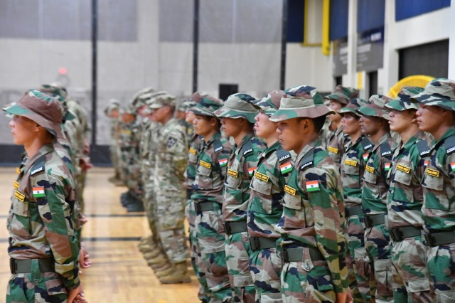 U.S. Army Soldiers from 7th Infantry Division and Indian Army soldiers participate in the closing ceremony for Yudh Abhyas 19 at Joint Base Lewis-McChord on Sept. 18  (U.S. Army photo by Staff Sgt. Joseph Tolliver, 1-2 Stryker Brigade Combat Team.)