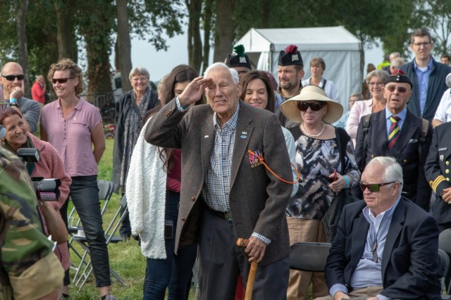 Gene Metcalfe, a World War II veteran and former POW, salutes the crowd after being awarded the Military Order of William in Groesbeek, Netherlands, Sept. 18, 2019. This event is just one of the many events commemorating the largest airborne operation in history, Operation Market Garden, which was aimed at liberating the Netherlands and gaining a foothold into Nazi Germany by crossing the Maas, Waal, and ultimately the Rhine River. To this day, generations of Dutch remember the bravery and sacrifice of more than 41,600 troops from the US, UK, and Poland who together constituted the Allied Airborne Army. This year marks the 75th anniversary of Operation Market Garden in the Netherlands. Commemorations honoring the Allied soldiers who participated in the historic airborne operation which liberated several Dutch towns take place Sept. 14-22, 2019.