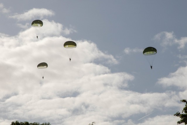 Dutch re-enactors, dressed as Soldiers of 82nd Airborne Division during World War II, parachute out of a Douglas C-47 Skytrain to commemorate the 75th anniversary of Operation Market Garden and begin the ceremony to present the Military Order of William to WWII veterans in Groesbeek, the Netherlands, Sept. 18th, 2019. This event is just one of the many events commemorating the largest airborne operation in history, Operation Market Garden, which was aimed at liberating the Netherlands and gaining a foothold into Nazi Germany by crossing the Maas, Waal, and ultimately the Rhine River. To this day, generations of Dutch remember the bravery and sacrifice of more than 41,600 troops from the US, UK, and Poland who together constituted the Allied Airborne Army. Commemorations honoring the Allied soldiers who participated in the historic airborne operation which liberated several Dutch towns take place Sept. 14-22, 2019.