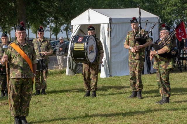 Dutch musicians of the 11th Airmobile Brigade, play during the commemoration of the 75th anniversary of Operation Market Garden and the presentation of the Military Order of William to WWII veterans in Groesbeek, the Netherlands on Sept. 18, 2019. This event is just one of the many events commemorating the largest airborne operation in history, Operation Market Garden, which was aimed at liberating the Netherlands and gaining a foothold into Nazi Germany by crossing the Maas, Waal, and ultimately the Rhine River. To this day, generations of Dutch remember the bravery and sacrifice of more than 41,600 troops from the US, UK, and Poland who together constituted the Allied Airborne Army. Commemorations honoring the Allied soldiers who participated in the historic airborne operation which liberated several Dutch towns take place Sept. 14-22, 2019.