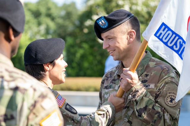 Lt. Col. Mary Rivera, left, commander, 5th Medical Recruiting Battalion, passes the company guidon to Capt. David Hilden, incoming commander, Houston Medical Recruiting Company, during the Houston MRC change of command ceremony at Hermann Park Conservancy, Houston, Texas, Sept. 5.