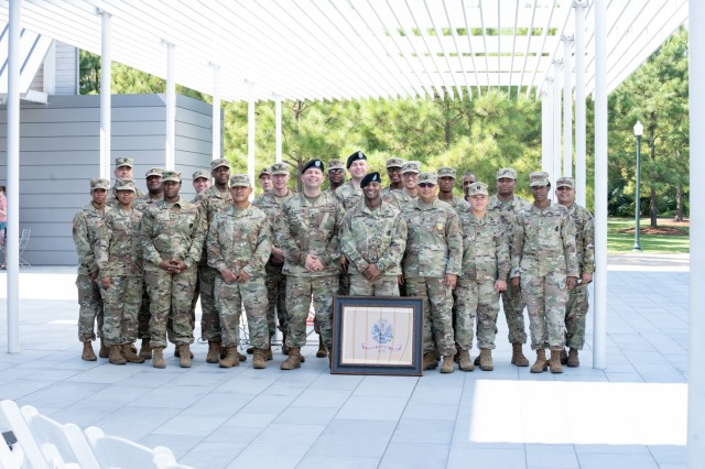 Soldiers assigned to the Houston Medical Recruiting Company pose for a group photo with Capt. Sanders, outgoing commander, Houston MRC, prior to the unit's change of command ceremony at Hermann Park Conservancy, Houston, Texas, Sept. 5.