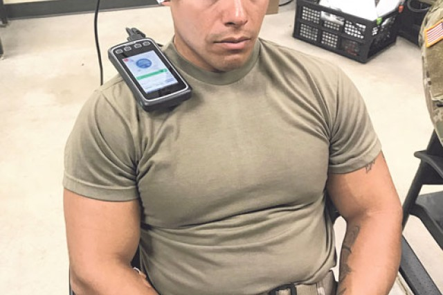 Staff Sgt. Pedro Soto gets scanned for brain activity markers before training in the Urban Mobility Breacher Course.
