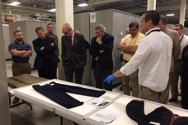 Mr. Paul Miller with the U.S. Army Center of Military History shows history professionals details about an actual Army Civil War uniform.