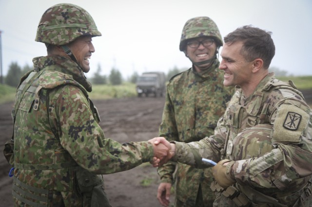 U.S. Army Lt. Col. Timothy Lynch, commander of 5th Battalion 3rd Field Artillery Regiment shakes hands with the battalion commander of Western Army Field Artillery of the Japan Ground Self-Defense Force at Yausubetsu Training Area, Japan, Sept. 16.