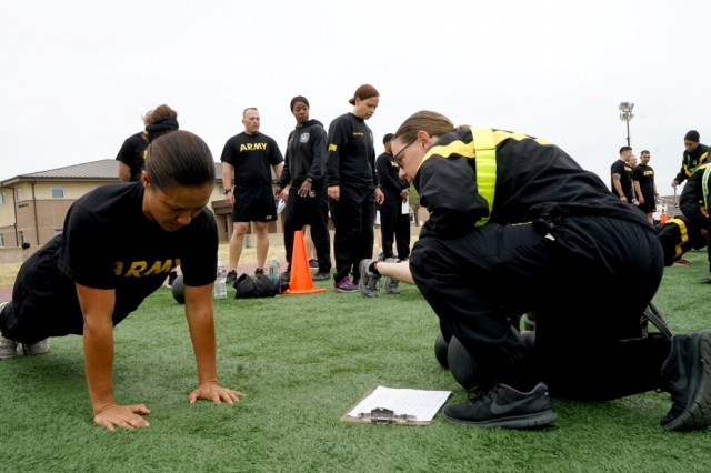 Capt. Lehuanani Halemano of the Hawaii Army National Guard performs hand-release push-ups during an Army Combat Fitness Test at Camp Parks in Dublin, Calif., May 10, 2019. Halemano traveled to California to attend the ACFT training, which was intended to prepare instructors and graders for the impending 2020 roll out of the new physical readiness assessment.