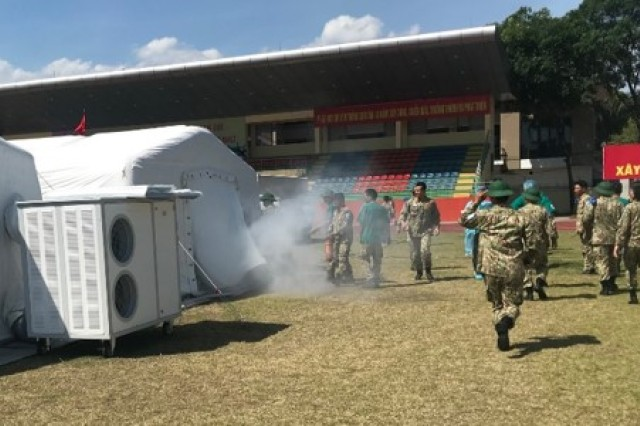 Military members from Military Hospital 103 respond to a scenario during which a fire is detected in the level II hospital June 22, in Hanoi, Vietnam.