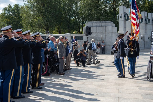 Soldiers from The U.S. Army Color Guard, 3d U.S. Infantry Regiment, present the Colors at the National WWII Memorial prior to a Bronze Star Medal award ceremony Washington, D.C., September 18, 2019. Former U.S. Army Cpl. Clarence Smoyer, along with the families of Pvt. Homer Davis, Pfc. John DeRiggi, and Tech. Cpl. William McVey, all received the Bronze Star Medal for their bravery as the five-man tank crew who stopped a German Panther tank that was destroying American tanks and troops on March 6, 1945.