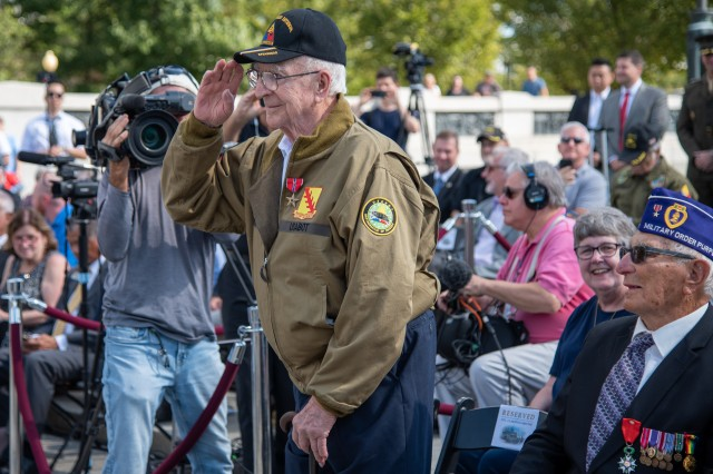 "Former U.S. Army Corporal and WWII veteran, Clarence Smoyer, renders a salute at the National WWII Memorial, Washington, D.C., September 18, 2019. Smoyer was awarded the Bronze Star Medal for his heroic actions as gunner of a five-man tank crew on March 6, 1945, when he fired the shots that stopped a German Panther tank that was destroying American tanks and troops and became known as ""The Hero of Cologne."""