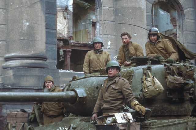 Clarence Smoyer (top middle) was a 21-year-old Pennsylvania native when he, and his fellow tank crew members, were photographed in Cologne, Germany, in 1945. This photo, courtesy of the National Archives, was taken moments after the battle of Cologne, Germany, and Smoyer delivered the fatal shots that destroyed a German tank. (Photo Credit: Courtesy of the National Archives)