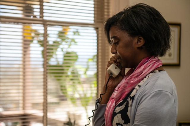 Aleshchai Herndon answers a phone in her office as sunflowers peak through her window at Presidio of Monterey, Aug. 28, 2019.