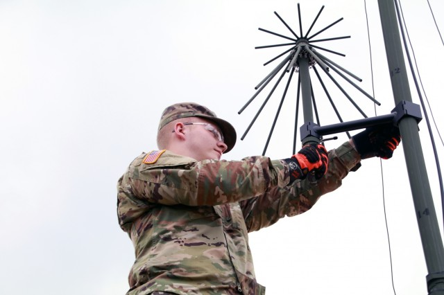 SAGAMIHARA, Japan - Pfc. Thaddeus F. Collins V, air defense battle management system operator, 38th Air Defense Artillery Brigade assembles an omni directional line-of-sight antenna used to enable communication with aviation assets during a unilateral joint training exercise designed to refine systems and concepts in order to enhance tactical planning, coordination and interoperability in a multi-domain environment on Sagami General Depot, Sept. 17.