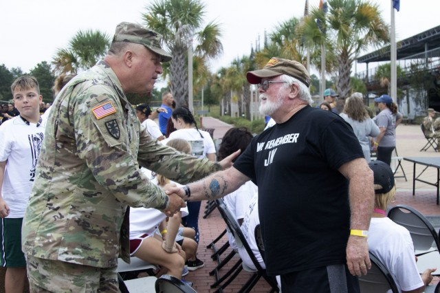 The Adjutant of South Carolina, Maj. Gen. Roy McCarty shakes hands with Ray Gannon, a former Marine and Gold Star Family Member. McCarty shook hands and thanked all the Gold Star Families for their fallen Family member's service.