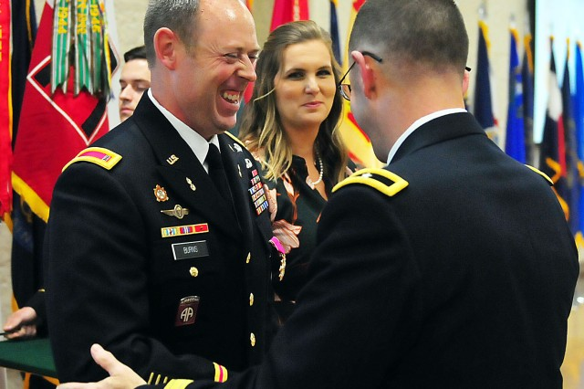 Chief Warrant Officer 4 Michael Burns, U.S. Army Sustainment Command, shares a light moment with Brig. Gen. Troy Galloway, deputy commanding general for operations, First U.S. Army, during the retirement ceremony Sept. 19 at Rock Island Arsenal, Illinois. (Photo by Jon Micheal Connor, ASC Public Affairs)
