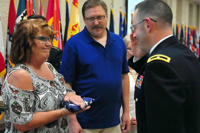 Cynthia Leonard, U.S. Army Sustainment Command, receives a salute from Brig. Gen. Troy Galloway, deputy commanding general for operations, First U.S. Army, during the retirement ceremony Sept. 19 at Rock Island Arsenal, Illinois. (Photo by Jon Micheal Connor, ASC Public Affairs)