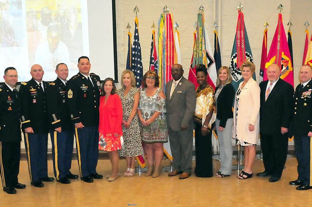 Retirees -- three Soldiers and eight civilians -- gather for a photograph following the  retirement ceremony held Sept. 19 in Heritage Hall, Rock Island Arsenal, Illinois. Brig. Gen. Troy Galloway (far left), presided over the ceremony assisted by Sgt. Maj. William Long (far right), both with First U.S. Army.  (Photo by Jon Micheal Connor, ASC Public Affairs)