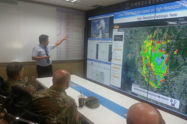 U.S. Army Corps of Engineers senior leaders are briefed in the satellite technology research center.