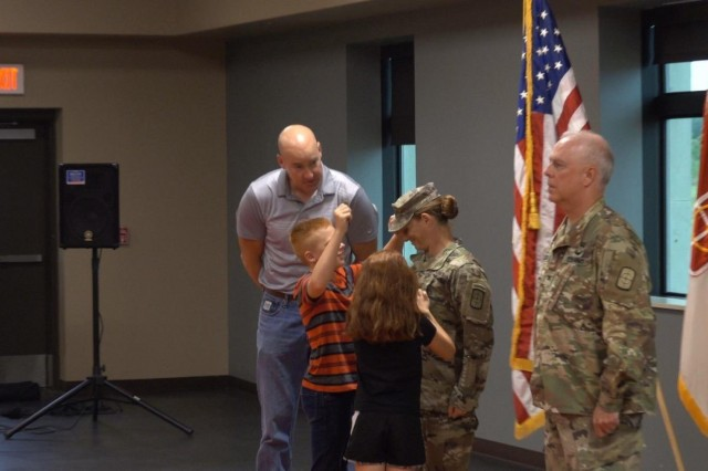 U.S. Army Reserve Lt. Col. Lisa Jaster, executive officer, 420th Engineer Brigade, receives a new patrol cap from her family signifying her promotion from Maj. to Lt. Col. Jaster graduated from Ranger School in 2015, and continues to serve in the military, work as the director of engineering for a M&S engineering, and conduct speaking engagements across the country.