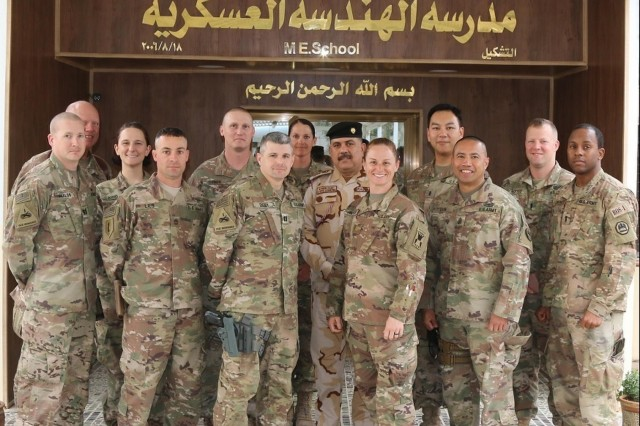 U.S. Army Reserve Maj. Lisa Jaster and Soldiers part of her engineering advising team pose in front of the Iraqi security forces Engineer School after their key leader engagement at Taji Military Complex, Iraq, Feb. 20, 2018. Now a Lt. Col., Jaster is serving as the executive officer for the U.S. Army Reserve's 420th Engineering brigade.