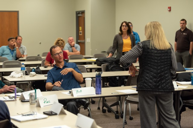 Leaders from the ATCALS/Range Threat Division engage in leadership exercises as part of corporate philosophy training.