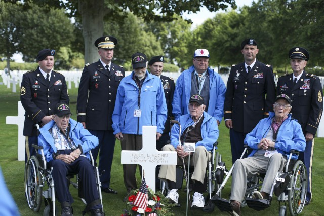 WWII Veterans who served in the 30th Infantry Division, and North Carolina National Guard Soldiers visit the graves of 30th Inf. Div. Soldiers buried at the Netherlands American Cemetery in Margraten, the Netherlands on Sept. 12, 2019. Four WWII Veterans who served in the 30th Infantry Division, traveled to the Netherlands with North Carolina National Guard Soldiers to celebrate the 75th anniversary of the Liberation of the Limburg Province in the Netherlands. The NCNG's 30th Armored Brigade Combat Team traces its lineage to the 30th Inf. Div. and still wears the same unit patch.