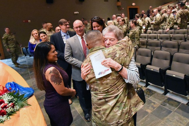 After the ceremony, Command Sgt. Maj. A.J. Santos and his wife, Patricia, receive well wishes from several who attended.