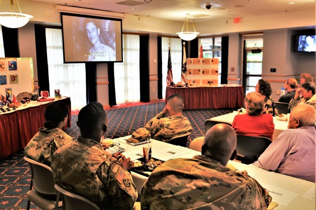 Fort McCoy, Wis., community members watch the documentary, The Borinqueneers, during the installation observance Sept. 19, 2019, of Hispanic Heritage Month. The documentary is about the Puerto Rican 65th Infantry Regiment. Dozens of people attended. Hispanic Heritage Month is held from Sept. 15 to Oct. 15 each year. It celebrates the histories, cultures, and contributions of American citizens whose ancestors came from Spain, Mexico, the Caribbean, and Central and South America. (U.S. Army Photo by Scott T. Sturkol, Public Affairs Office, Fort McCoy, Wis.)