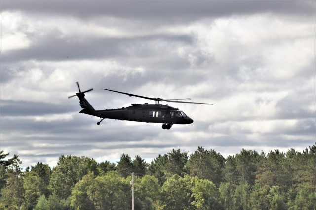 An aircrew flies a UH-60 Black Hawk helicopter over the cantonment area during training operations Sept. 6, 2019, at Fort McCoy, Wis. According to the Army fact sheet for the Black Hawk, its mission is to provide air assault, general support, aeromedical evacuation, command and control, and special operations support to combat, stability, and support operations. The UH-60 also is the Army's utility tactical transport helicopter. The versatile helicopter has enhanced the overall mobility of the Army due to dramatic improvements in troop capacity and cargo lift capability over the years as well. (U.S. Army Photo by Scott T. Sturkol, Public Affairs Office, Fort McCoy, Wis.)