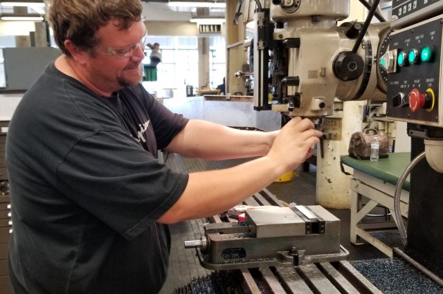 Brad Tyler, apprentice, cleans a machining center while attending the Rock Island Arsenal - Joint Manufacturing and Technology Center's apprenticeship program. Tyler will receive his journeyman certification upon completion of the four-year program.