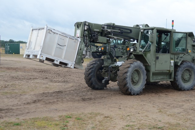 An unmanned forklift moves cargo around North FOB, Camp Grayling, Michigan, August 28, 2019.  Engineers, scientists, Soldiers and program managers from the U.S. Army Ground Vehicle Systems Center and the U.K.'s Defence Science and Technology Laboratory demonstrate the Coalition Autonomous Assured Resupply project, highlight the interoperability of the two nations' armies with autonomous driving technology.  [U.S. Army photo by Jerome Aliotta//Released]