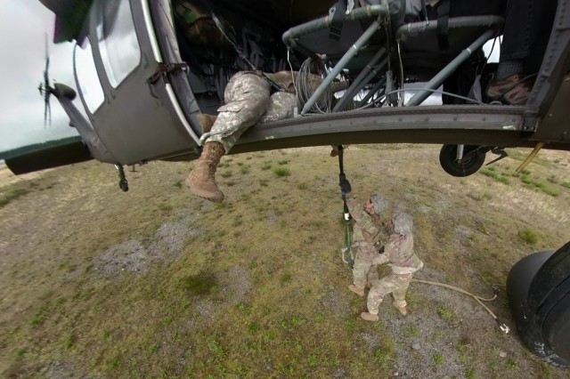 In this photo clip of a 360-degree-view, aircrews from 2nd Battalion, 158th Aviation Regiment, 16th Combat Aviation Brigade and support personnel from 1-2 Stryker Brigade Combat Team conduct sling load operations at Gray Army Airfield, Joint Base Lewis-McChord, Wash., during a logistics resupply mission during operational tests of Army modernization efforts with a new digital cockpit in the UH--60V Black Hawk helicopter.