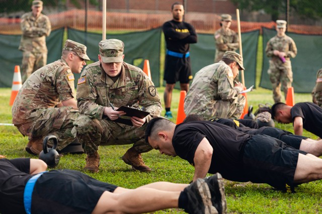 Staff Sgt. Gabriel Wright, a signals intelligence analyst with the 780th Military intelligence Brigade, grades the Hand-Release Push-Up event May 17, 2019, as part of Army Combat Fitness Test Level II Grader validation training, held at Fort Meade, Md.