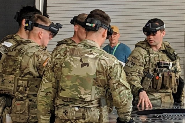 Soldiers perform an after-action review through their IVAS devices after navigating through a shoot house. IVAS is designed to increase Soldier lethality, mobility and situational awareness by providing enhanced night and thermal vision capabilities, map displays and data collection capabilities. (Photo by PEO Soldier)