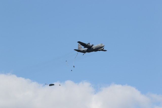XVIII Airborne Corps Soldiers parachute from a C-130H Hercules September 18, 2019, at Sicily Drop Zone, Fort Bragg, N.C. The operation was the first jump in over a year for a number of Corps' Soldiers who recently returned from a 12-month deployment to the Middle East. (U.S. Army photo by Pfc. Daniel J. Alkana/22nd Mobile Public Affairs Detachment)